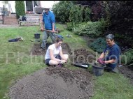 Trench in the back garden of Mr & Mrs Merrit's house. Lorraine Watkinson, Archaeologist (front right), Robin Daniels Archaeology Officer Tees Archaeology (centre) Lauren Walker, volunteer (rear)