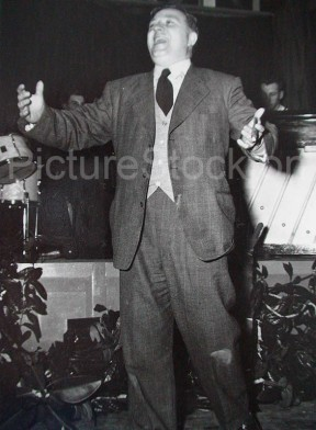 John R Tinning after the War singing at an ICI function